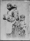 Armenian_woman_and_her_children_from_Geghi,_1899
