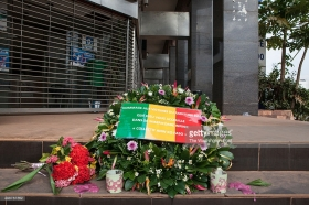 Bamako, Mali- A small memorial outside of the Radisson Blu Hotel three days after an attack by Al Mourabitoun, an Al-Qaeda affiliate that killed close to two dozen people in Bamako, Mali on Monday, November 23, 2015. (Jane Hahn for the Washington Post)