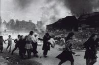 Palestinian Refugees Fleeing East Beirut Massacre 1976, printed 2013 Don McCullin born 1935 ARTIST ROOMS Tate and National Galleries of Scotland. Purchased with the assistance of the ARTIST ROOMS Endowment, supported by the Henry Moore Foundation and Tate Members 2014 http://www.tate.org.uk/art/work/AR01207
